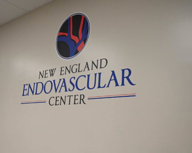 New England Endovascular Center Logo On Wall